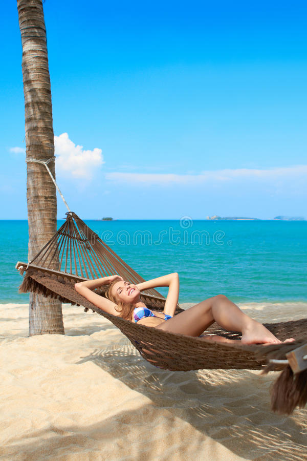 Woman enjoying the serenity of a tropical beach stock photos