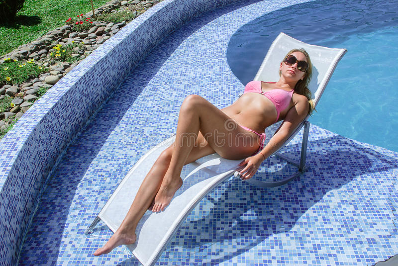 Woman enjoying summer in the pool royalty free stock photo