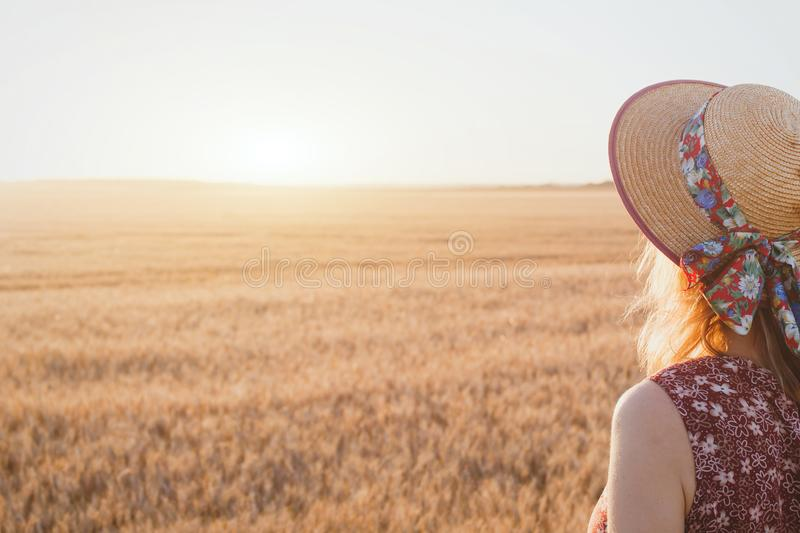 Woman enjoying summer sunset stock photo