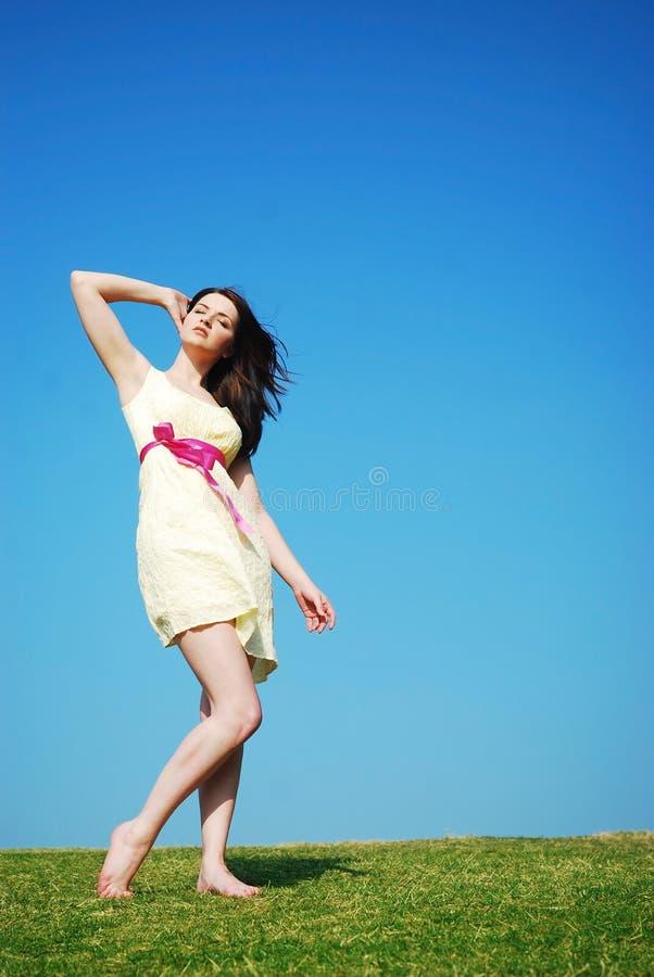 Woman enjoying the sun stock photo