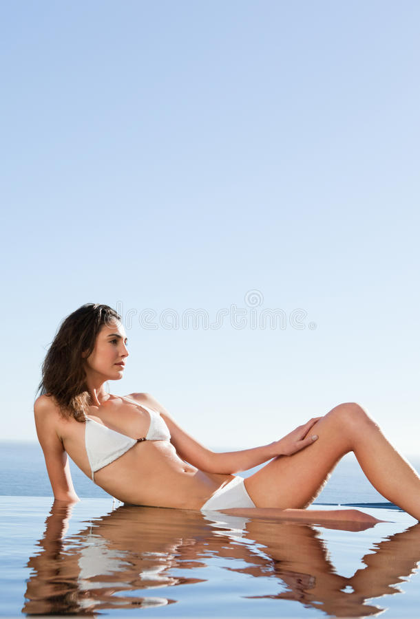 Download Woman Enjoying The Sun On Pool Edge Stock Image - Image: 22440597