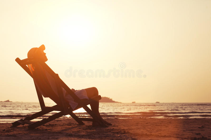 Woman enjoying sunset on the beach royalty free stock images