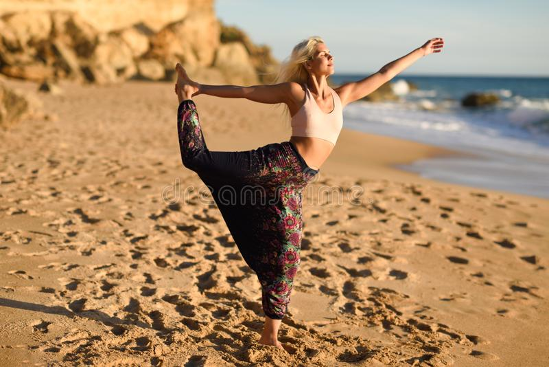 Woman enjoying the sunset on a beautiful beach royalty free stock images
