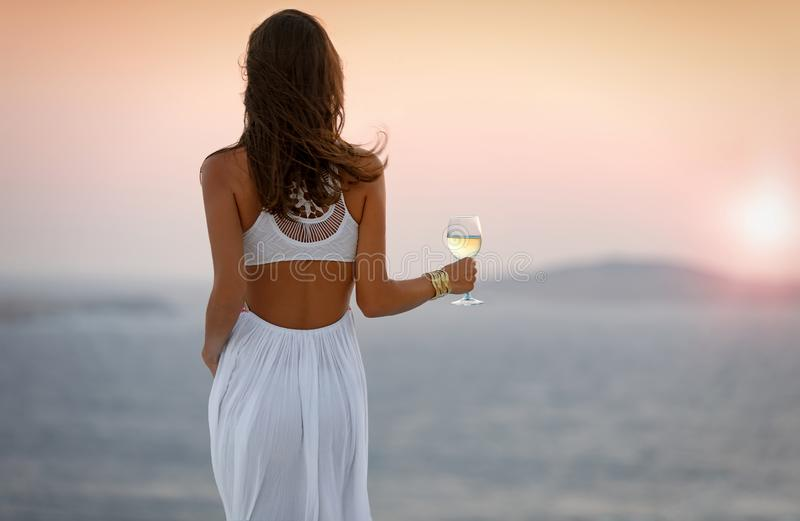 Woman is enjoying the sunset royalty free stock image