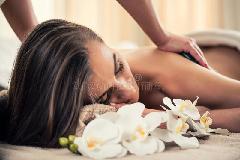 Woman enjoying the therapeutic effects of a traditional hot ston stock images
