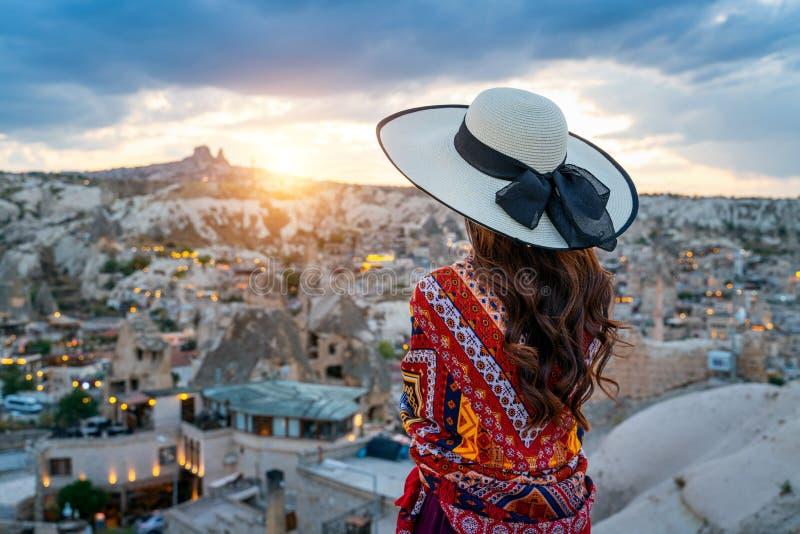 Woman enjoying view of Goreme town, Cappadocia in Turkey. royalty free stock photos
