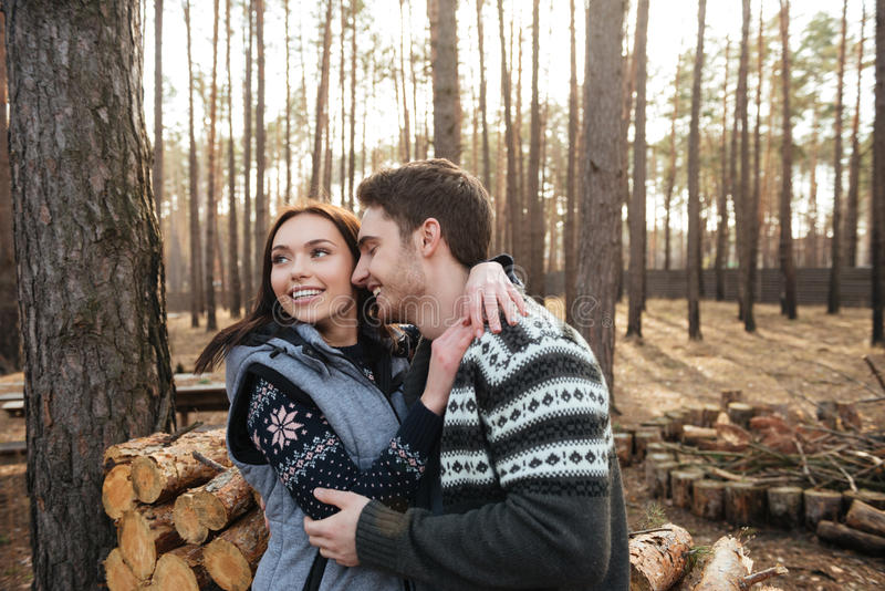 Woman enjoying walking in forest with her man royalty free stock photo