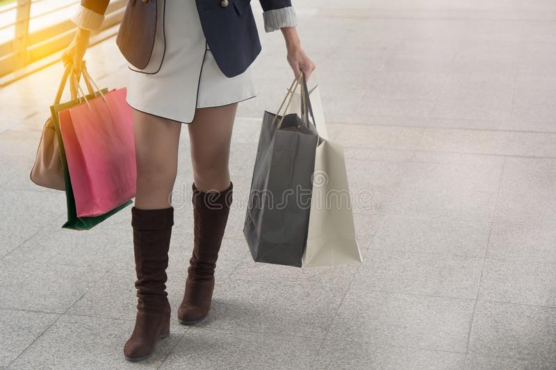 Woman enjoying the weekend in shopping royalty free stock image