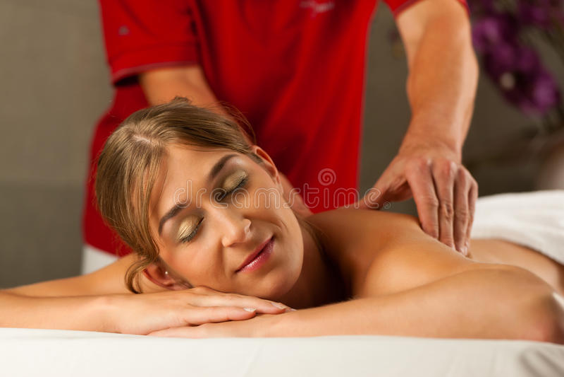 Woman enjoying wellness back massage. Woman enjoying a wellness back massage in a spa, she is very relaxed (close-up stock images