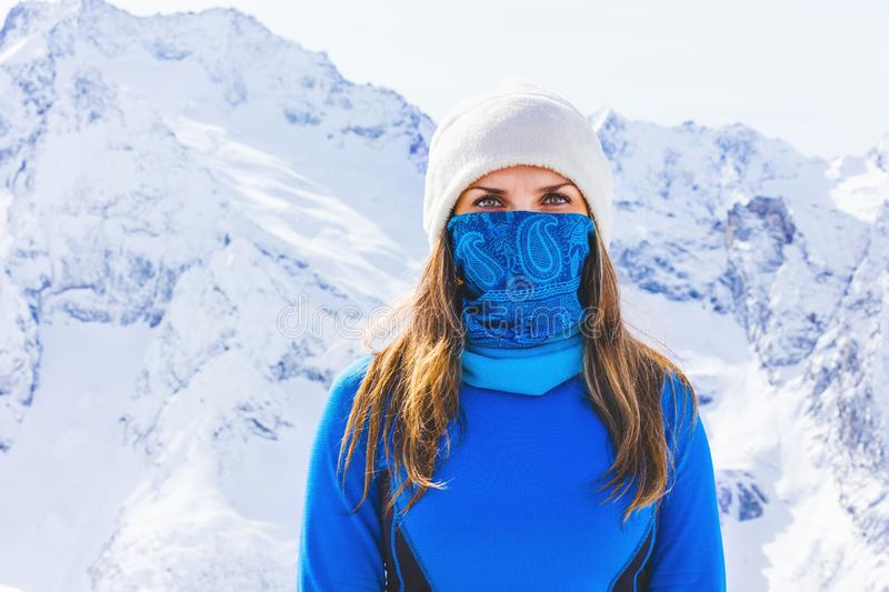 Portrait of a girl on the background of snowy mountains stock images