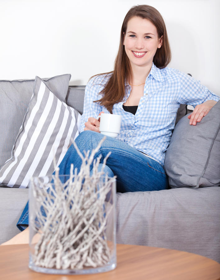 Free Woman Enjoys A Cup Of Coffee Stock Photography - 46666072