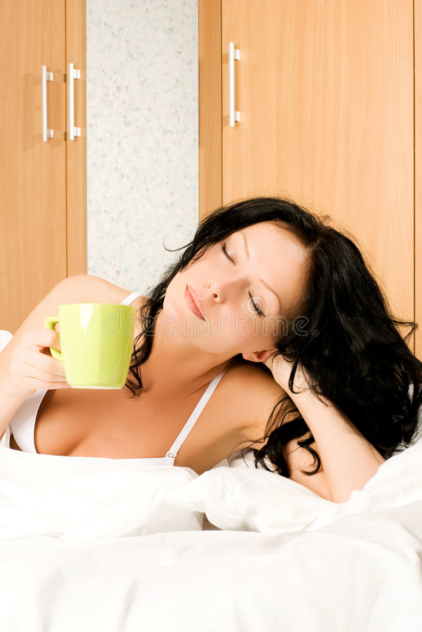 Free Woman Enjoys A Cup Of Coffee Royalty Free Stock Image - 7222296