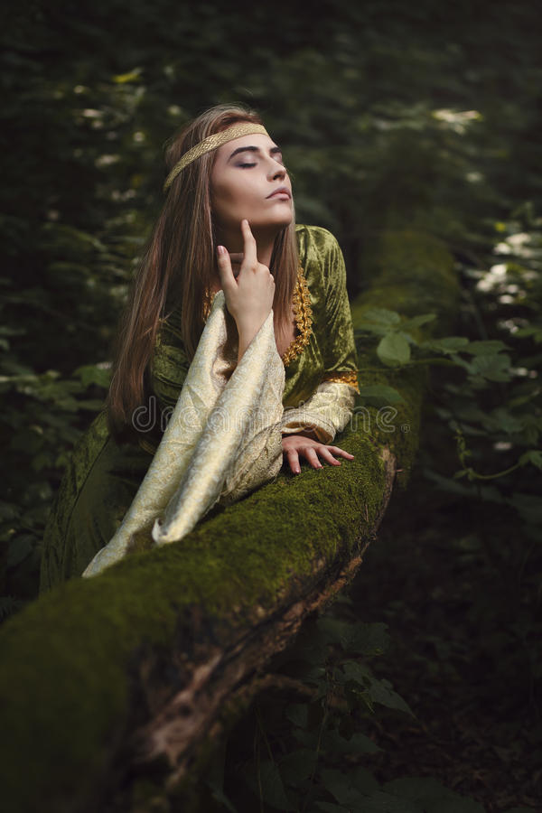 Woman enjoys forest beauty stock images