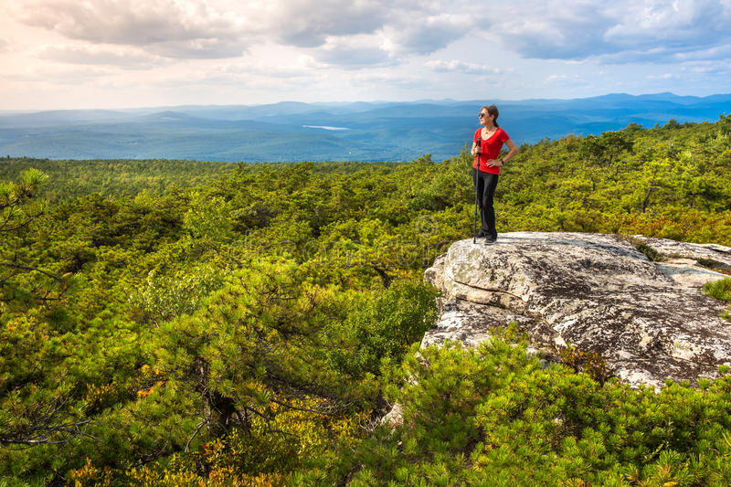 Woman enjoys the nature. At High Point, on top of Shawangunk Ridge, in Upstate New York royalty free stock images