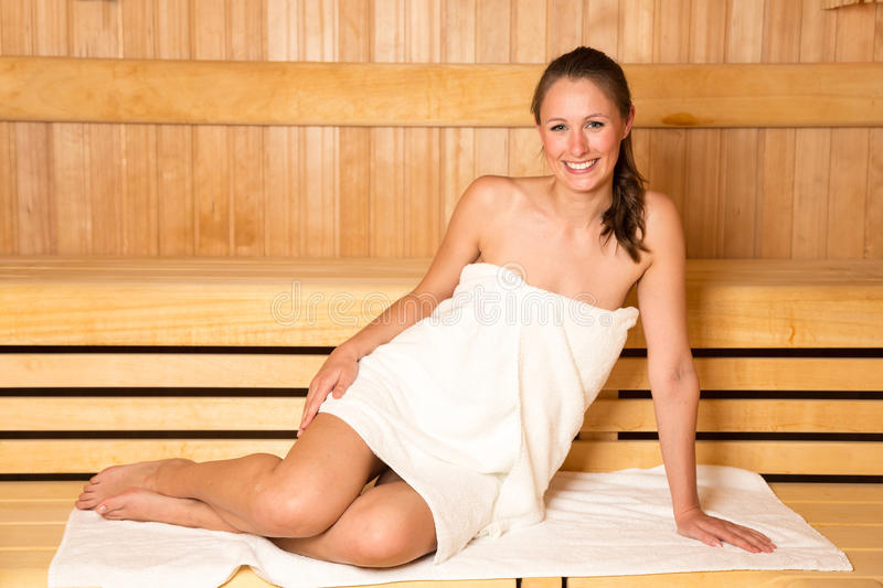 Woman enjoys wellness day in a sauna royalty free stock images