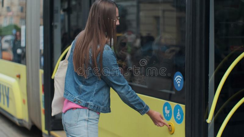 Woman entering the door of the modern tram at the station. Woman entering the door of the modern tram at the station royalty free stock photography