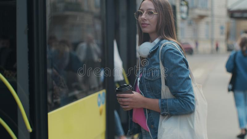 Woman entering the door of the modern tram at the station. Woman entering the door of the modern tram at the station royalty free stock image