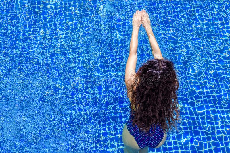 Woman enters the water. Swimmer launched into water. Woman in pool. royalty free stock photos