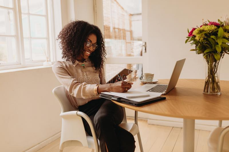 Woman entrepreneur working from home on laptop stock photos