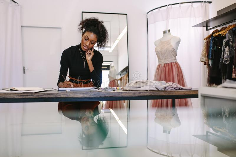 Woman entrepreneur at work in her boutique stock image
