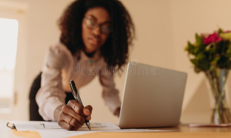 Woman entrepreneur working from home stock images