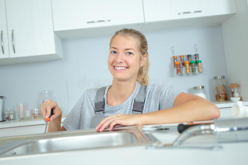 Woman in equality plumbing industry. A woman in equality plumbing industry stock photo