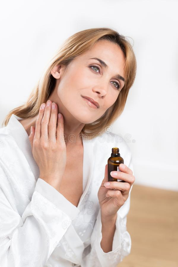 Woman with essential oils stock photos