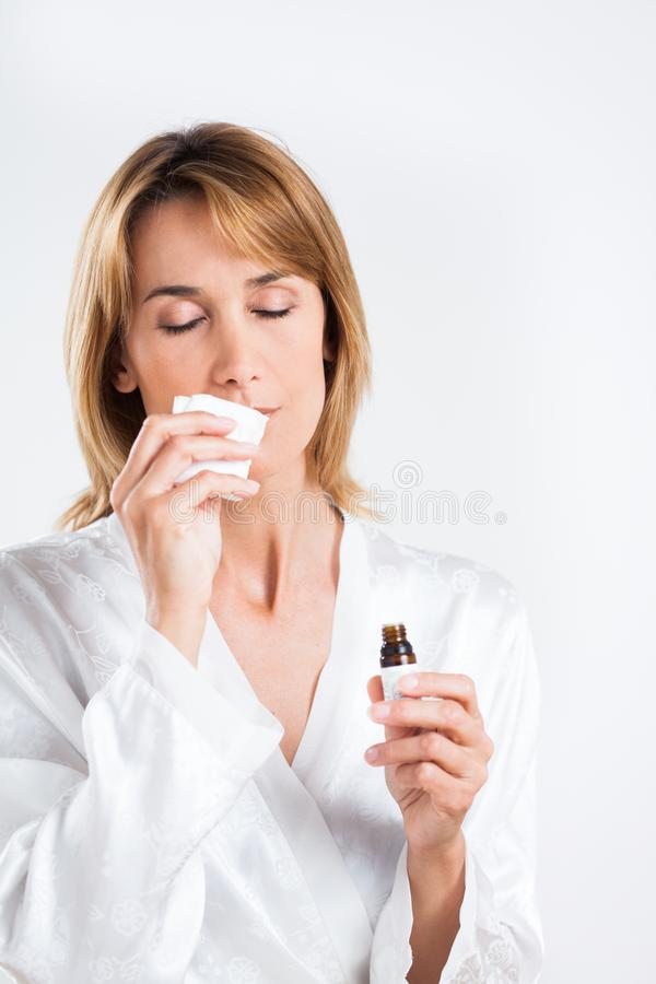 Woman with essential oils royalty free stock photography