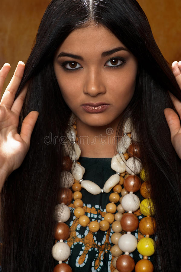 Woman in ethnic dress stock images