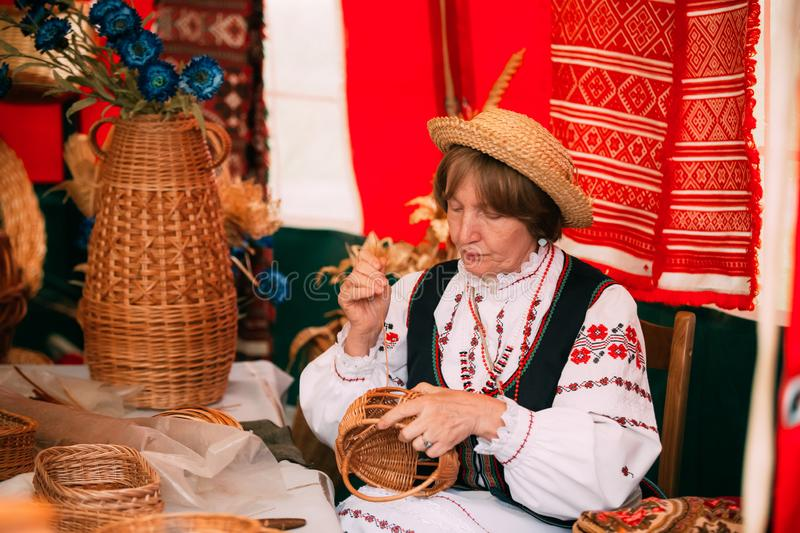 Woman In Ethnic Traditional Folks National Russian Costume Weavi royalty free stock images