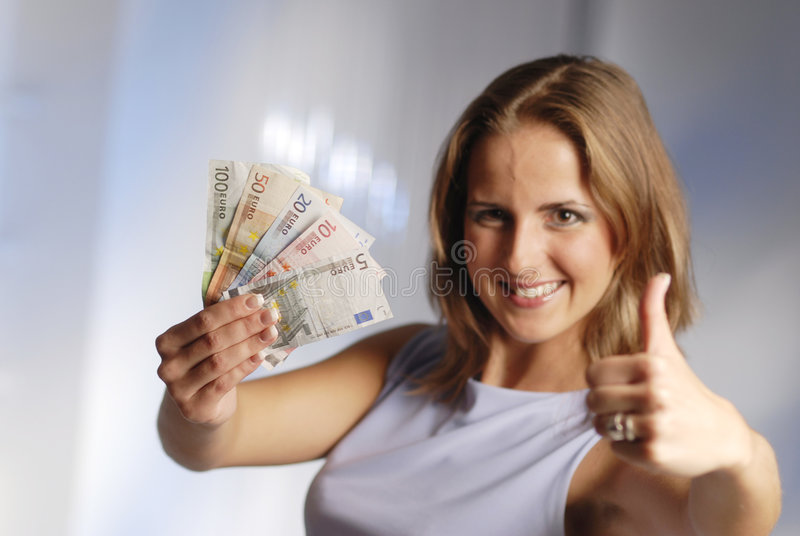 Woman with Euro. The young attractive woman with the euro banknotes royalty free stock photography