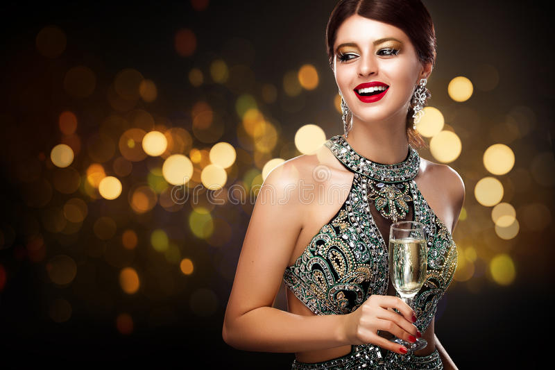 Woman in evening dress with champagne glasses - St valentine`s day celebration. New Year and Chrismtas stock photo