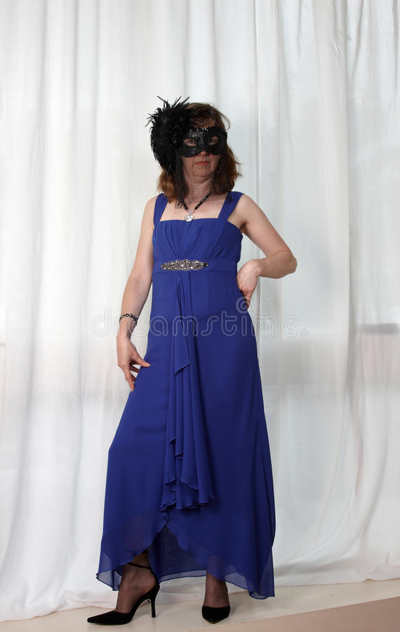 A woman in evening dress and mask royalty free stock photography