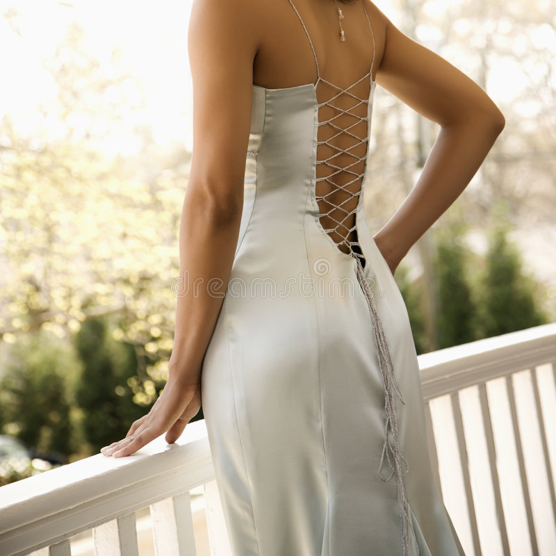 Woman in evening gown. Close-up of African-American woman in evening gown stock photos