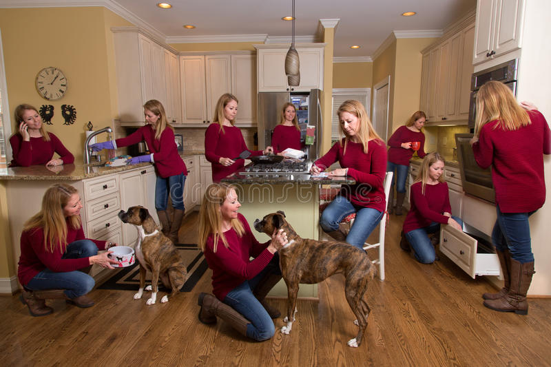 Woman everywhere in kitchen. Composite of woman 'everywhere' in kitchen - doing dishes, cooking, feeding and petting dog, having coffee, baking and talking on stock photography