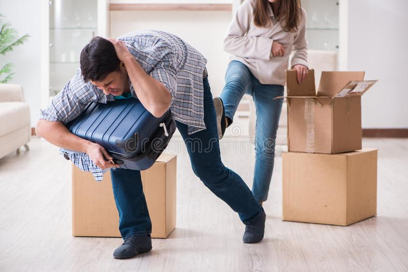 The woman evicting man from house during family conflict stock photo