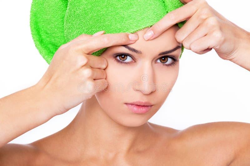 Woman examining face. royalty free stock photo