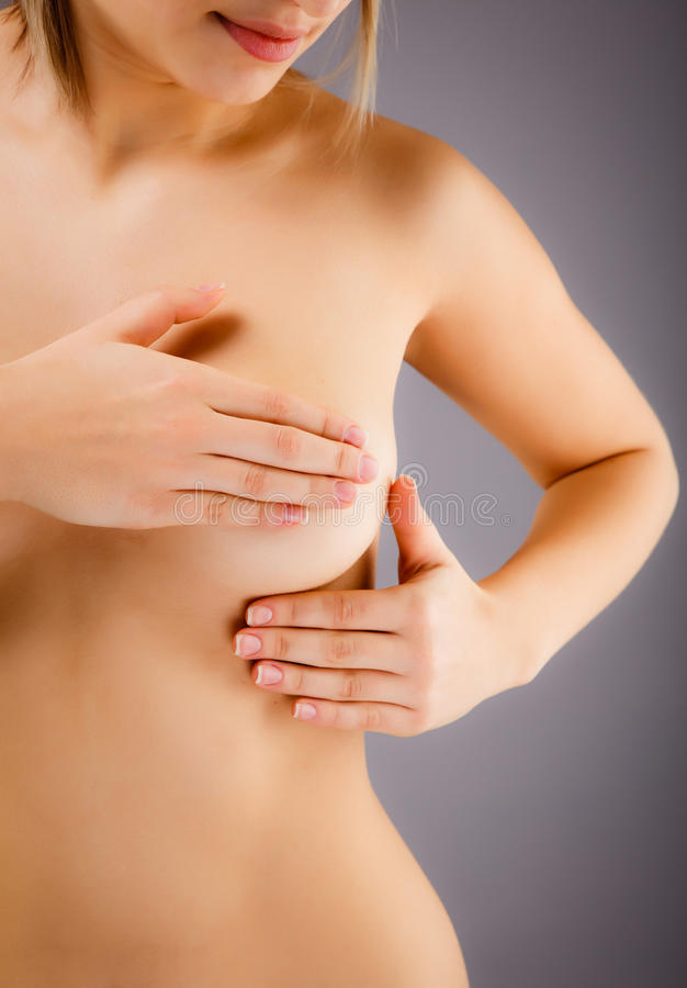 Woman examining her breast stock image