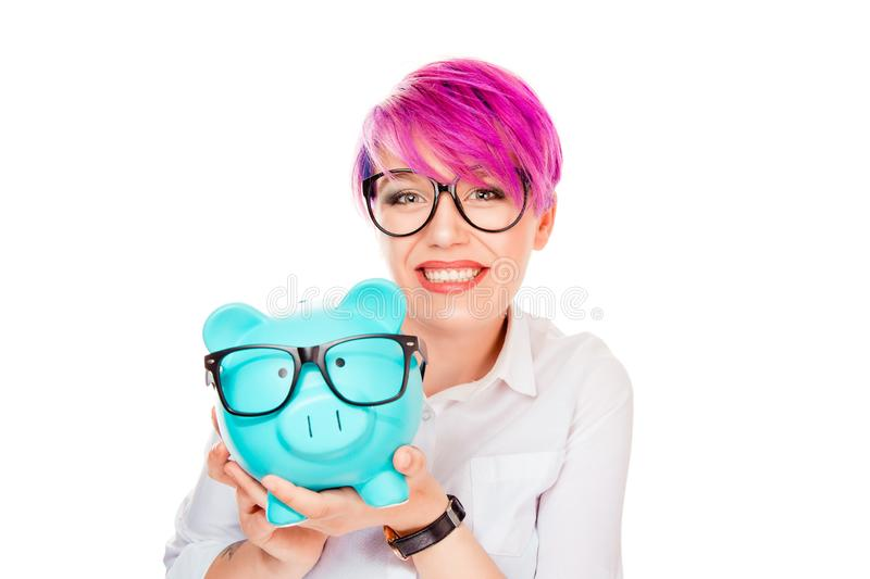 Woman excited over savings on buying eyeglasses. Happy woman excited over savings on buying eyeglasses. Piggy bank and girl wearing glasses isolated on white stock photos