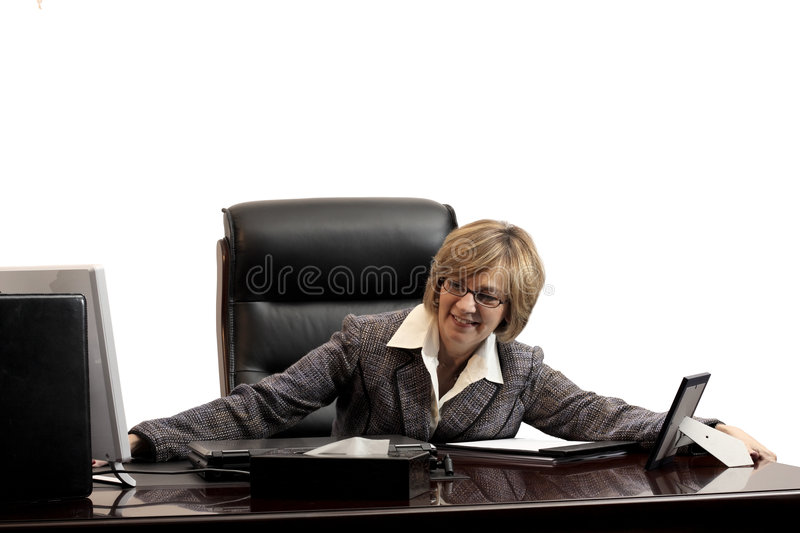 Woman executive- acheiving a new position. Woman executive showing her feeling of success in getting a new position in her new office stock photo