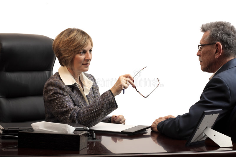 Woman executive - coaching an employee. Woman executive coaching a male employee stock images