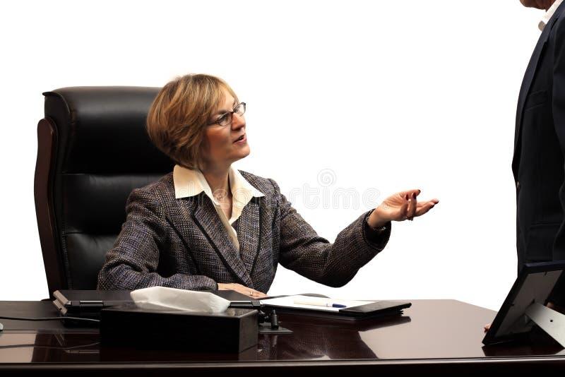 Woman Executive - Teamwork. Woman executive coaching a team memebr royalty free stock image