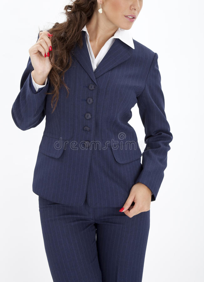 Woman in an executive uniform. Beautiful woman in a blue executive uniform royalty free stock photography