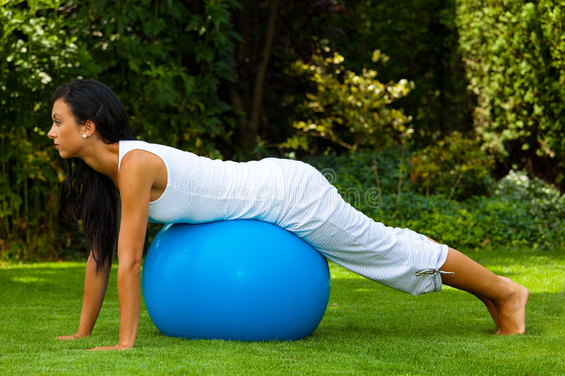 Woman with exercise ball stock image