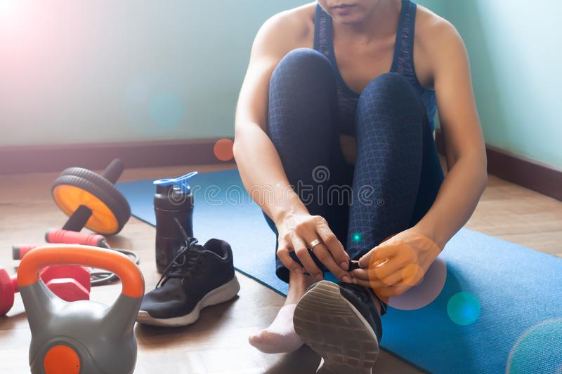 Woman exercise at home, Healthy lifestyle. Woman`s health and beauty concept stock photography