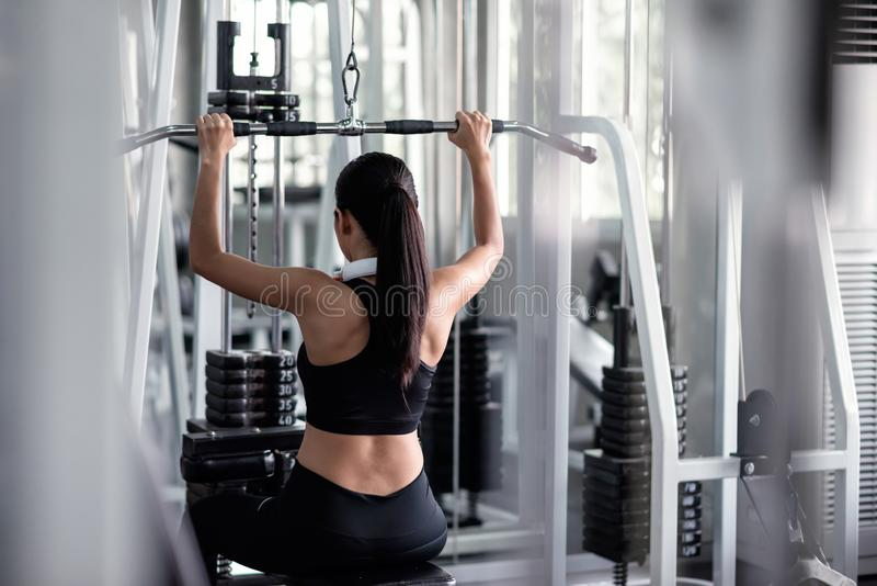 woman exercise with lat pulldown machine in gym royalty free stock photo