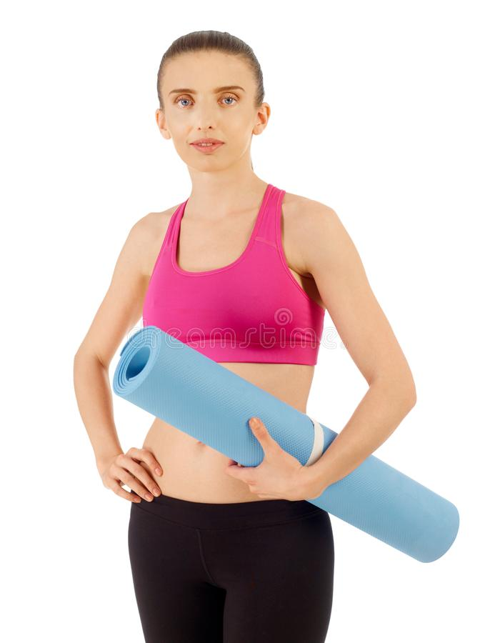 Woman with exercise mat royalty free stock images