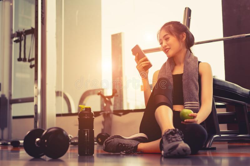 Woman exercise workout in gym fitness breaking relax stock images