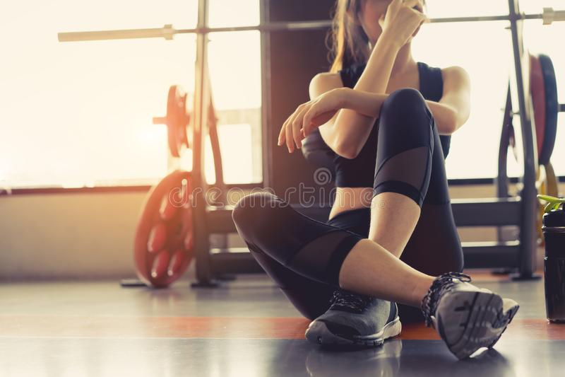 Woman exercise workout in gym fitness breaking relax stock photos