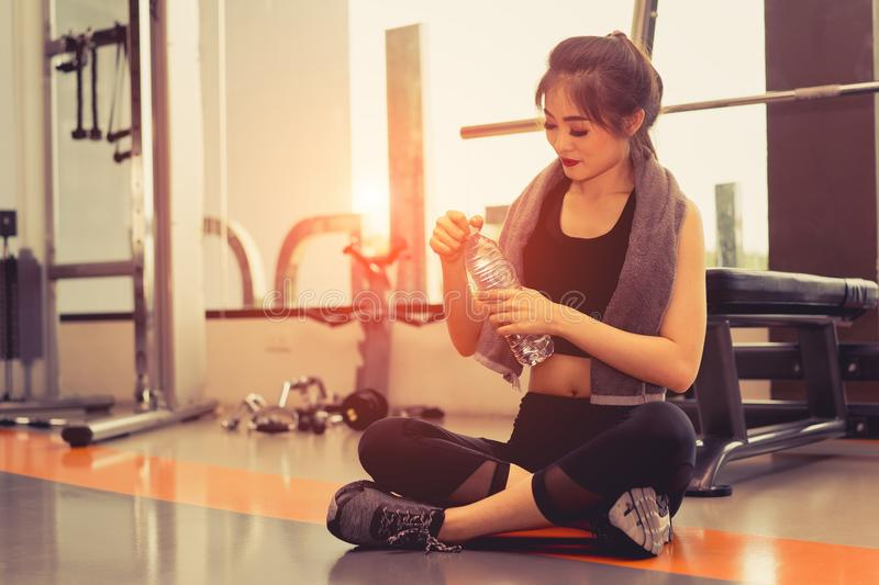 Woman exercise workout in gym fitness breaking relax stock image
